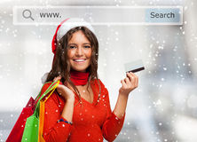 Woman showing her credit card while shopping before Christmas Stock Image