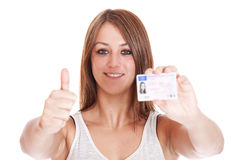 Woman showing her drivers license Royalty Free Stock Images