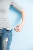 Woman showing her empty pockets Stock Photography