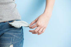 Woman showing her empty pockets Stock Image