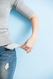 Woman showing her empty pockets Stock Images