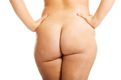 Woman showing her fat buttocks Royalty Free Stock Image
