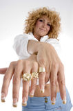 Woman showing her finger rings. On an isolated background Stock Images