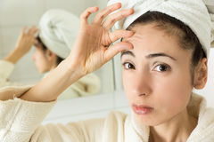 Woman showing her forehead wrinkles Stock Image