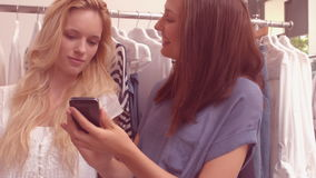 Woman showing her friend a dress stock footage