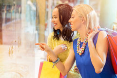 Woman showing her friend something that she wants Royalty Free Stock Photo