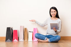 Woman showing her gift ordered from internet at home Royalty Free Stock Photo