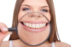Woman showing her healthy teeth Stock Photo