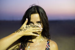 Woman showing her henna painting Stock Photo
