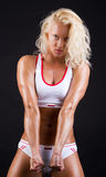 Woman showing her muscles Royalty Free Stock Photo
