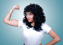Woman showing her muscles. Young sexy woman showing her muscles Stock Photography
