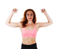 Woman showing her muscles. Stock Photo
