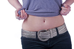 Woman showing her navel piercing. Stock Image