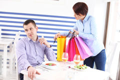 Woman showing her new purchase to husband Royalty Free Stock Photography