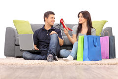 Woman showing her new shoes to her boyfriend Royalty Free Stock Photo