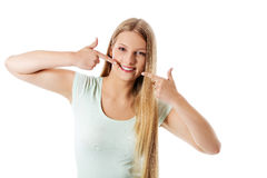 Woman showing her perfect straight white teeth. Royalty Free Stock Photo