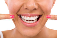 Woman showing her perfect teeth Stock Images