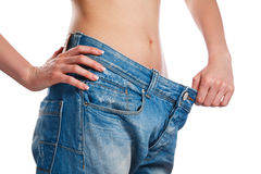 Woman showing her progress after weight loss Stock Photography