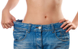 Woman showing her progress after weight loss Royalty Free Stock Images