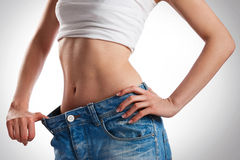 Woman showing her progress after weight loss Royalty Free Stock Photo