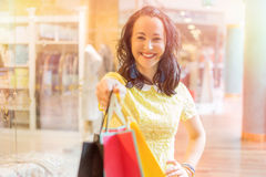 Woman showing her shopping bags Royalty Free Stock Photography