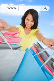 Woman showing her shopping bags under address bar Stock Photography