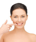 Woman showing her teeth Royalty Free Stock Photography
