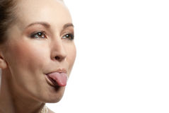 Woman showing her tongue Royalty Free Stock Photos