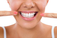 Woman showing her white teeth. Stock Photography
