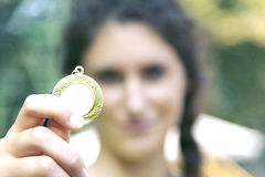 Woman showing his medal Royalty Free Stock Photography