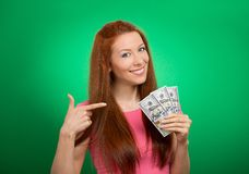 Woman showing holding money dollar bills Stock Photo