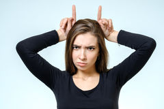 Woman showing horns with her fingers Royalty Free Stock Image