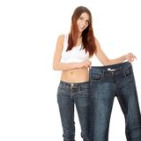 Woman showing how much weight she lost.   Stock Photography