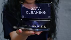 Woman showing HUD hologram Data cleaning