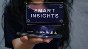 Woman showing HUD hologram smart insights. Unrecognizable curly brunette woman showing HUD hologram with text Smart insights. Girl uses technology of the future stock video