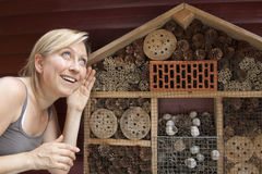 Woman showing insect hotel Stock Photo
