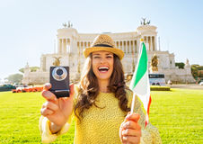 Woman showing italian flag and photo camera Stock Photos