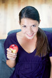 Woman showing a juicy red apple royalty free stock photo