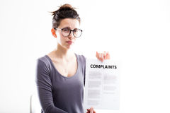 Woman showing just received complaints Stock Photo