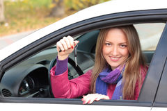 Woman showing the key of her new car Royalty Free Stock Images