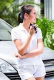 Woman showing key of new car Royalty Free Stock Photos