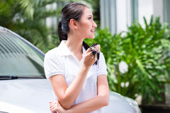 Woman showing key of new car Stock Photo