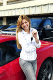 Woman showing key of new red  car Stock Image