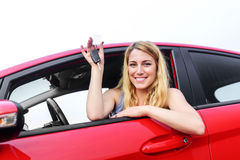 Woman showing keys. Attractive blonde in a car showing keys Royalty Free Stock Photos