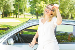 Woman showing keys of car. Happy young woman showing keys of her new car Royalty Free Stock Photo