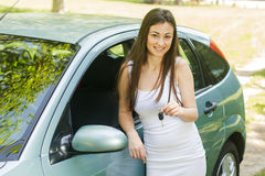 Woman showing keys of new car. Happy young woman showing keys of new car Royalty Free Stock Photo