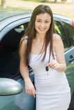 Woman showing keys of new car. Happy young woman showing keys of new car Stock Image