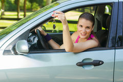 Woman showing keys of new car Royalty Free Stock Photo