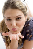 Woman showing kissing gesture Royalty Free Stock Image