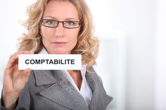 Woman showing label Stock Photo